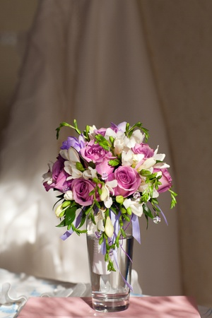 freesia: bouquet of flowers and wedding dress Stock Photo
