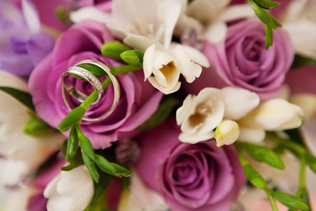 bouquet of roses and wedding rings Stock Photo
