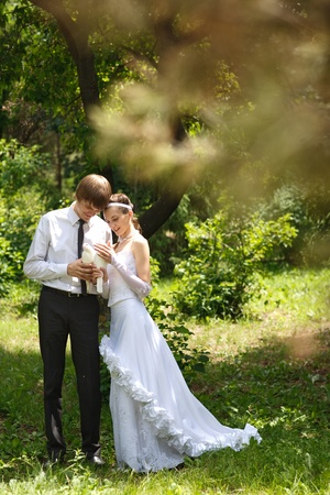 bridal couple: bride and groom with pigeons Stock Photo