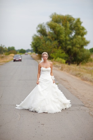 abandoned car: a bride along on the road