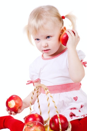 small girl with red apples photo