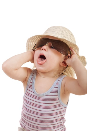 child in sunglasses with opened mouth photo