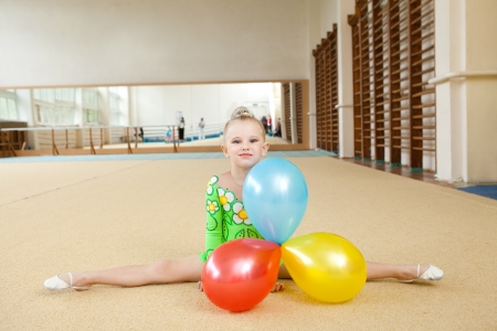 acrobatic: young gymnast in the gym Stock Photo