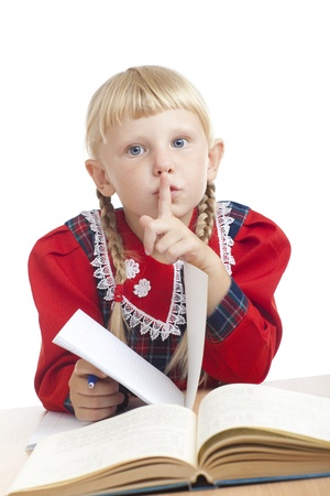 industrious: small girl with opened book show silence Stock Photo