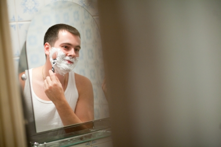 man shaving in his bathroom photo