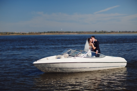 happy couple on the yacht photo