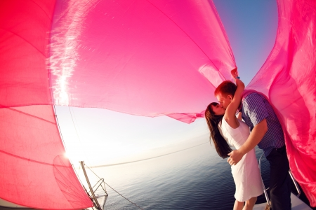 kissing man and girl under the sail Standard-Bild