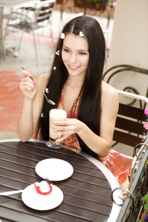 cute girl with long hair: girl drinking coffee in cafe