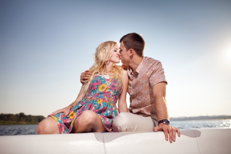 kissing happy couple on the boat photo
