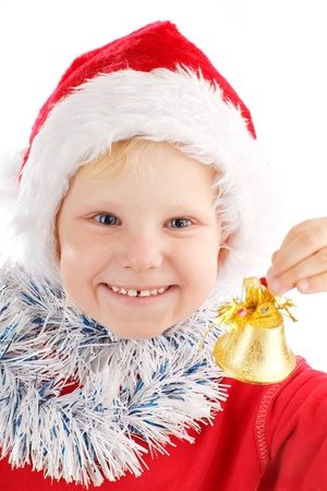 santa cap: portrait of a child with Christmas bell