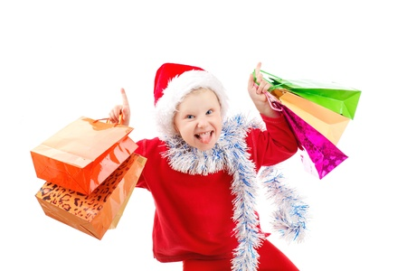 Child dressed as Santa with bags of presents photo