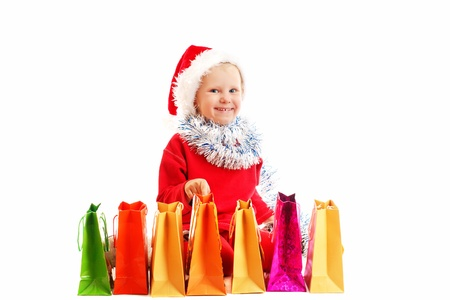 child  in red cap with Christmas presents photo