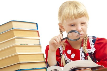 little girl reading with loupe