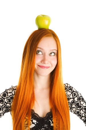red haired: red haired girl with an apple on the head Stock Photo