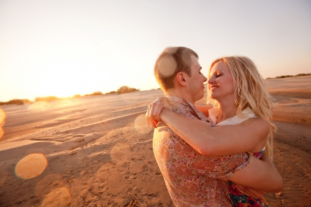 happy couple on the beach photo