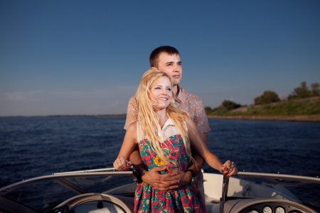 young happy couple on the boat photo