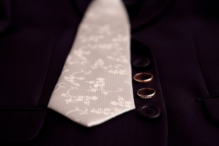 tie and wedding rings photo
