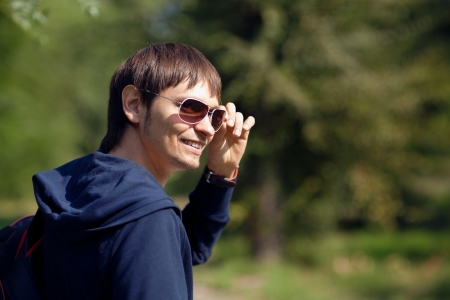 happy young man in sunglasses photo