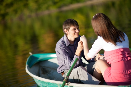 couple in a boat outdoors photo