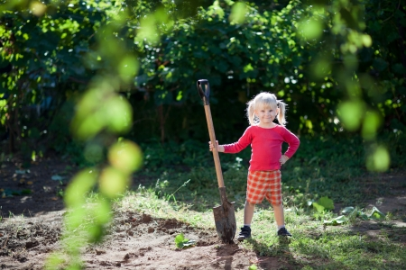helps: small girl helps to dig Stock Photo