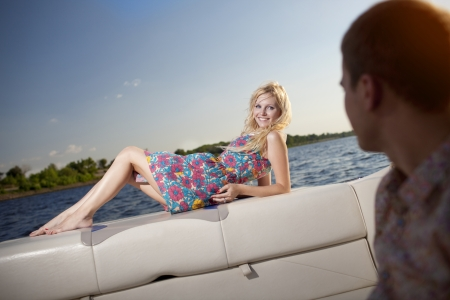yacht people: young happy couple on the boat