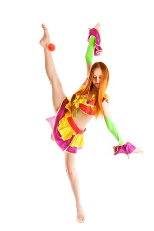 acrobat gymnast: girl in a costume of a clown