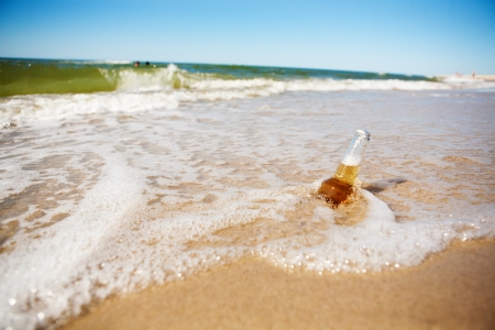 bottle of beer in the sea photo