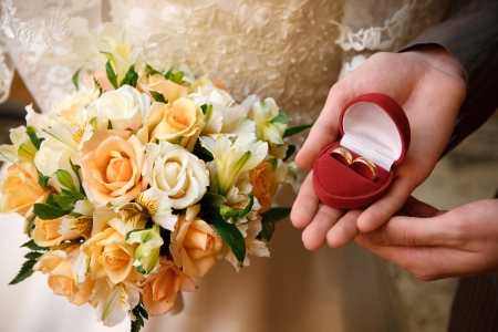 wedding rings and bouquet photo