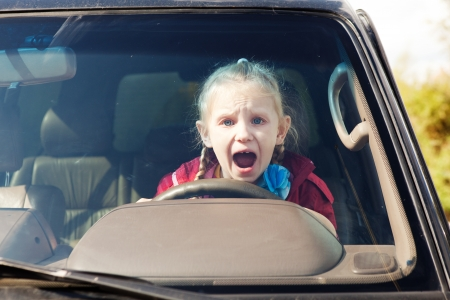scared girl: Crying scared girl driving the car