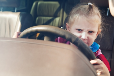 learner: small girl driving a car Stock Photo