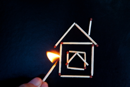 Burning Match In Hand Near The Model Of The House Stock Photo, Picture And  Royalty Free Image. Image 23018109.