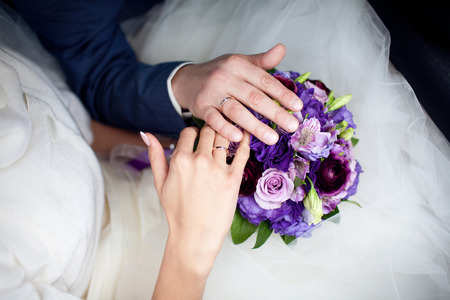 hands on wedding bouquet photo