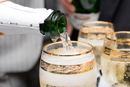 birthday champagne: pouring champagne in glasses Stock Photo