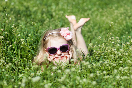 barefooted: small barefooted girl in grass