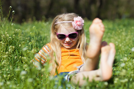 good looks: small barefooted girl in grass