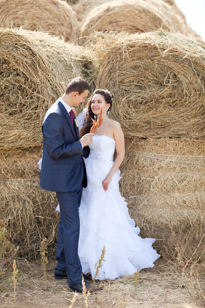 couple near the hay