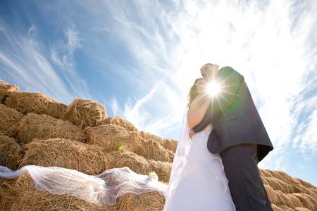 couple near the hay photo