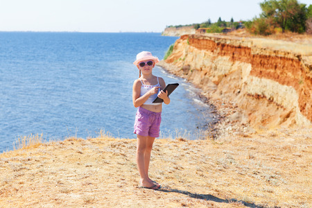 girl on the beach with laptop photo