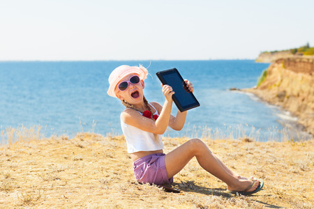 crying girl on the beach with laptop