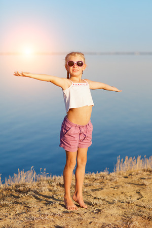 girl doing exercises on the beach photo