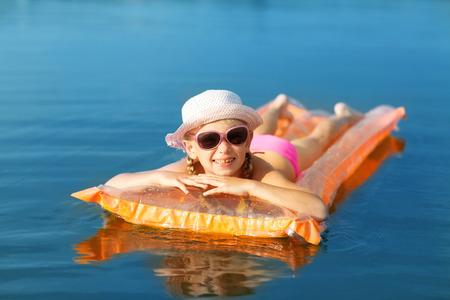 girl on the swimming mattress photo