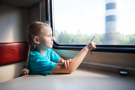 small girl in the train photo