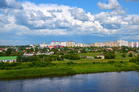 lake district: Construction of a new microdistrict in the Siberian city against the backdrop of the river.