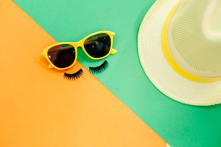 Straw Beach Womans Hat Sun Glasses Top View Yellow Background Flat Single