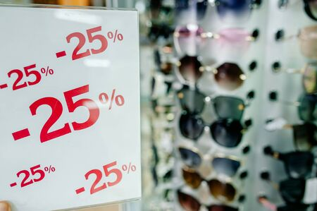 Assorted sunglasses for sale at a local market with nice discounted lenses and apparel for all kinds of people to wear. Improves vision and reduces UV glare.