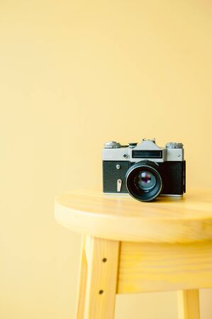 vintage camera with yellow paper background