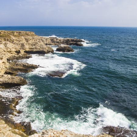 Cape Tarkhankut. Crimea. Rocky slopes and waves at sea. natural wallpaper. copyspace Imagens