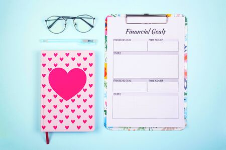 Bright modern notebooks and checklists for keeping personal finances and creating savings. Layout on a bright neo-mint background.