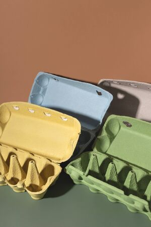 Colored trays from eggs. Garbage collection for recycling concept.