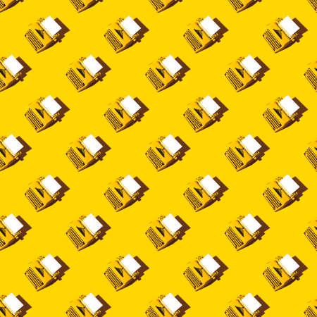 Yellow bright typewriter on a yellow background. Creativity concept 版權商用圖片